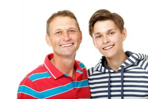 Father with son teen happy smiling over white background